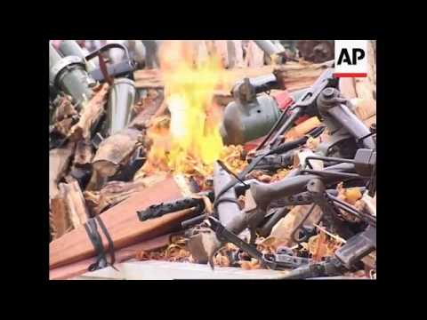 Ivory Coast president visits former rebel stronghold, burns weapons