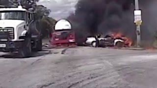 Watch Officers Save a Woman Trapped in Her Burning Car