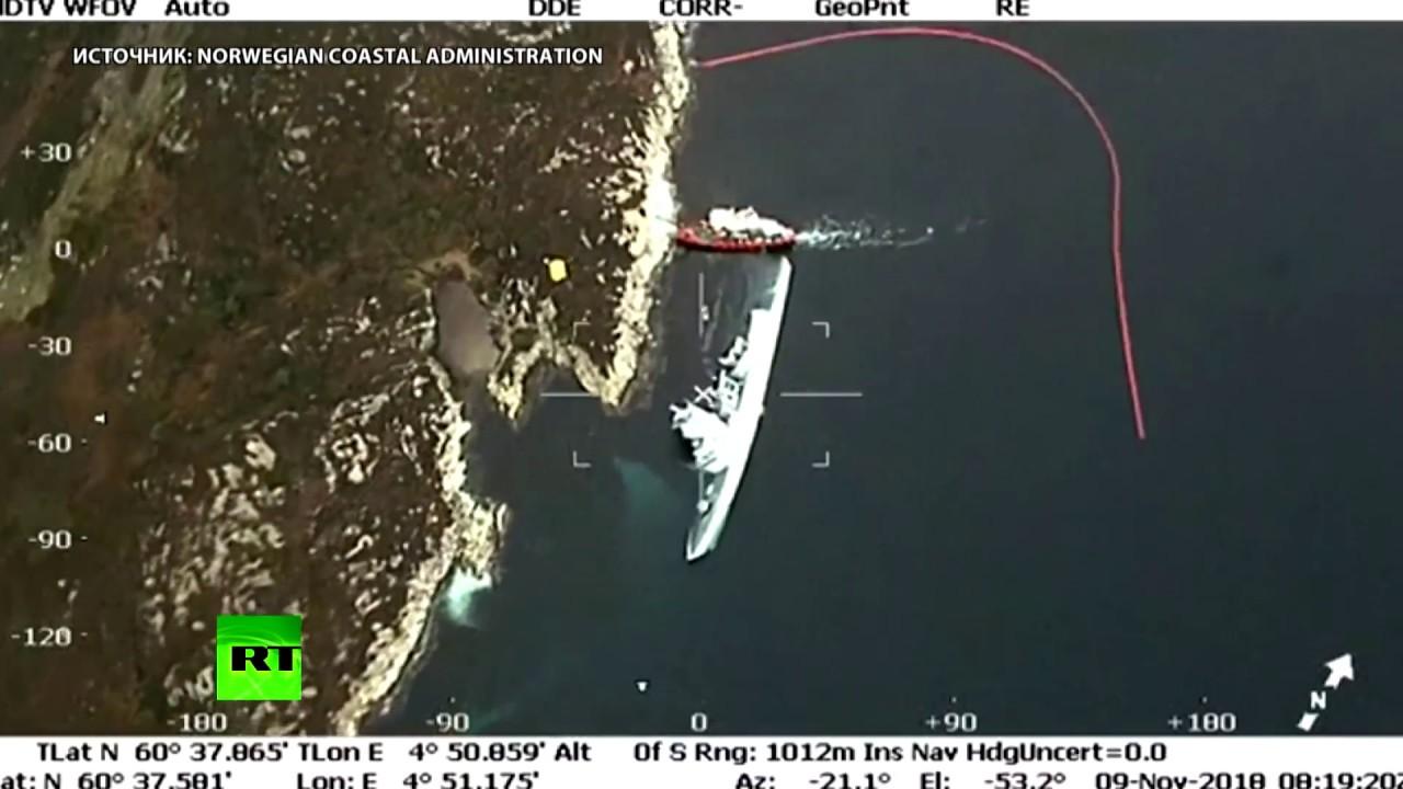 Вертолёт заснял лежащий на боку корабль ВМС Норвегии