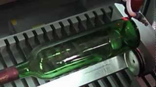 Laser rotary engraving on glass bottle, China laser machine