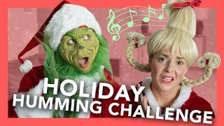Grinch Holiday Humming Challenge (ft. Grace Helbig)