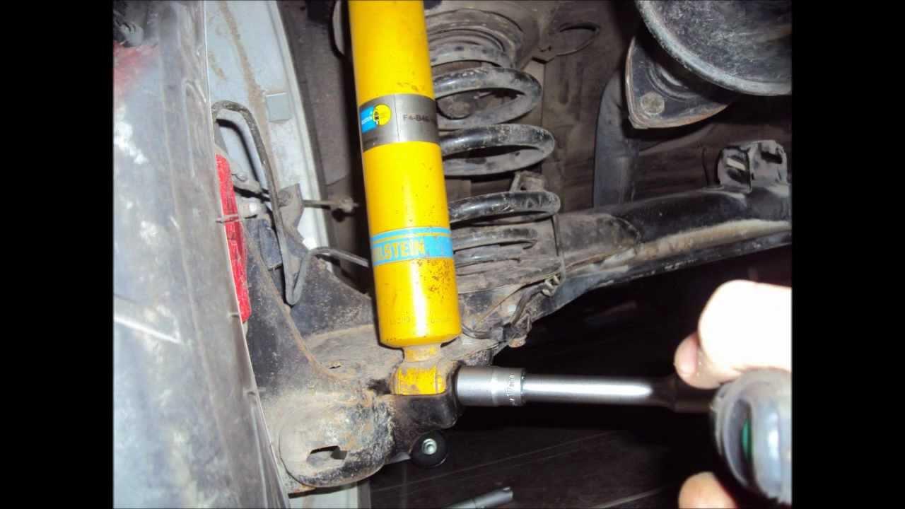 Desmontar montar amortiguador trasero y cambio for Suspension sejour