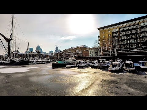 Ice and Snow in London. Frozen Canal in Limehouse Basin. Walk Around