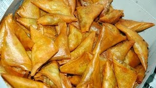 Making of andhra samosa: this video shows how to make and cook triangle samosa in telugu with english subtitles. for more snacks recipe videos: https:...
