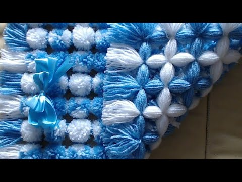 Pom pom blanket. LOOK How to add two tone pom poms.