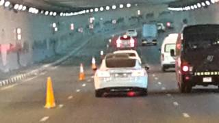 Tesla Car driving Jumeirah Palm tunnel in Dubai