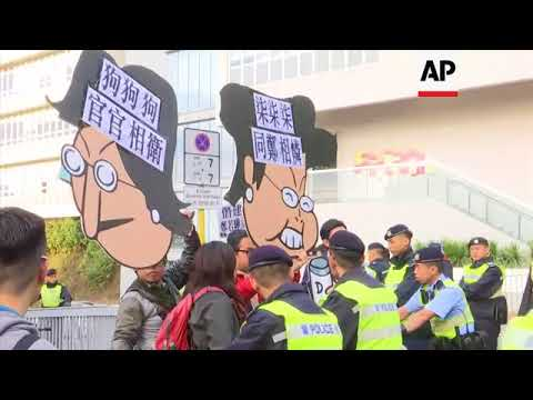 Protest outside polling station where Hong Kong's chief executive to vote
