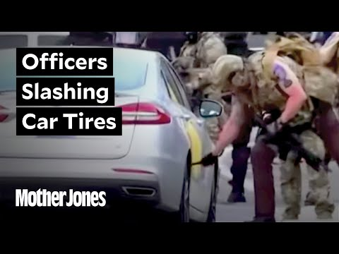 watch:-cops-slash-car-tires-at-protests-in-minneapolis