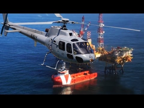 Rigworker arriving with helicopter on oil-platform
