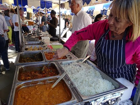 72 year old Indian Street Food Vendor serving up a Spinach & Sweetcorn + Potato Curry Wrap, London.