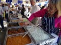 72 Year Old Indian Street Food Vendor Serving Up A Spinach & Sweetcorn   Potato Curry Wrap, London.