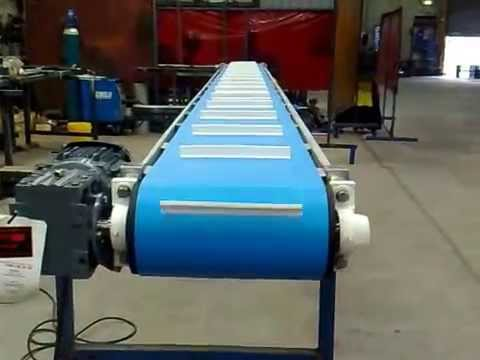 Cleated belt conveyors