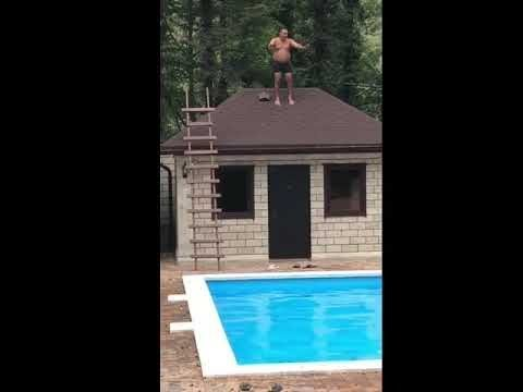 Pool Dive Fails   Jump fail from roof to pool man face plants concrete