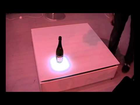 Interactive table with LED lighting that react with the environment.