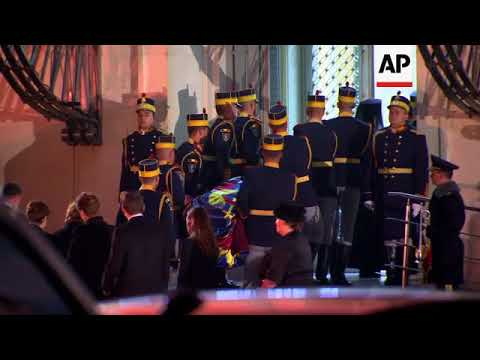 Late Romanian king's coffin arrives at royal palace in Bucharest
