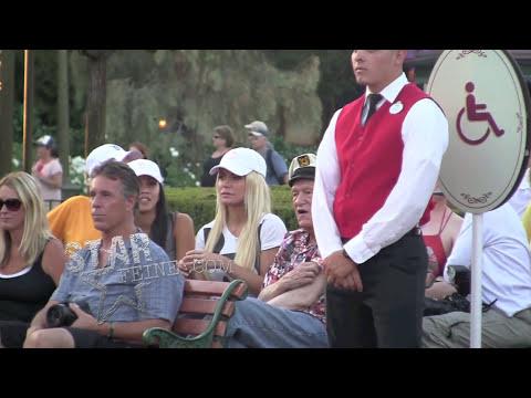 EXCLUSIVE\: Hugh Hefner and wife Crystal Harris Hefner scoot around Disneyland and watch the parade.