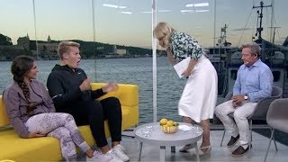 Norwegian TV-host throws up on guest on live TV