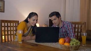 Indian Mother and Son working on laptop - Small nuclear family, son checking the study material