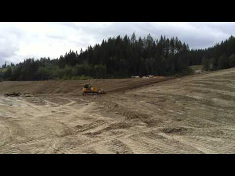 John deere 850J finishing slope on reclamation project