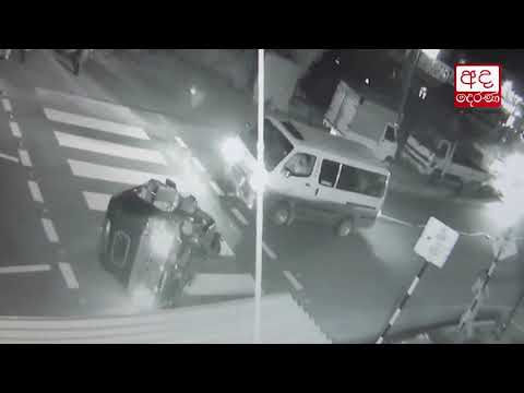 CCTV: Two injured after three-wheeler topples in collision