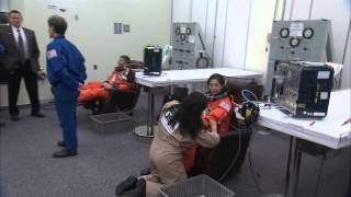 STS-133 Discovery - Crew gets Suited Up