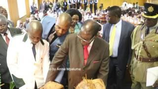 President Mugabe blowing candles on his @93  birthday cake