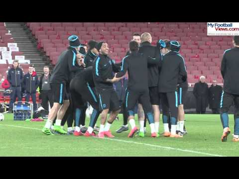 Luis Suarez mobbed by Barcelona team-mates in training