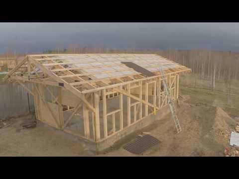 видео: Каркасный гараж-мастерская в одиночку / garage framing alone
