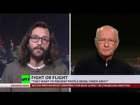 Activists found guilty of blocking flight deporting asylum seekers (Debate)