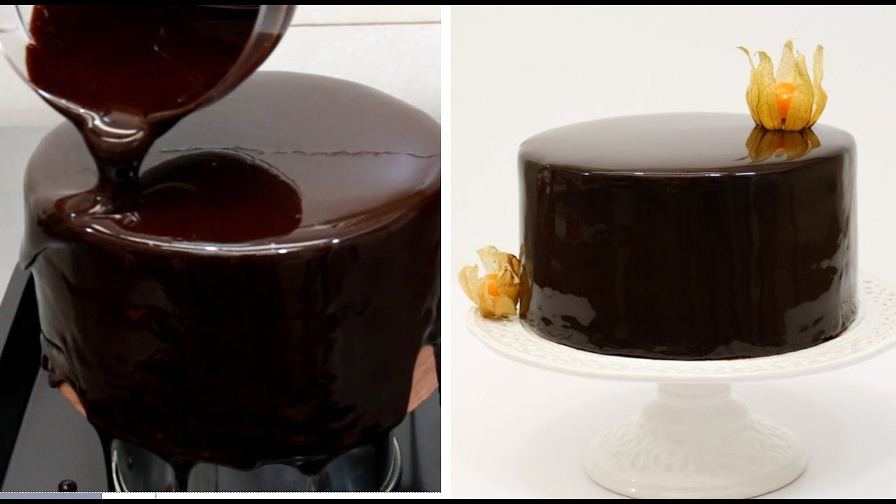 a cake being covered in a chocolate mirror glaze