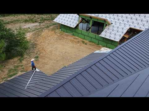 Installing standing seam metal roof in montgomery tx