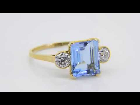 Buy aquamarine and diamond three-stone...