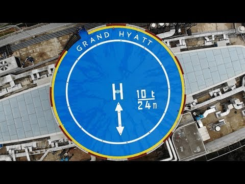 What looks like taking off my Mavic Drone from a real heliport?