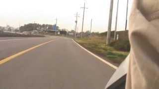 a foreigner riding a scooter on jeju island south korea