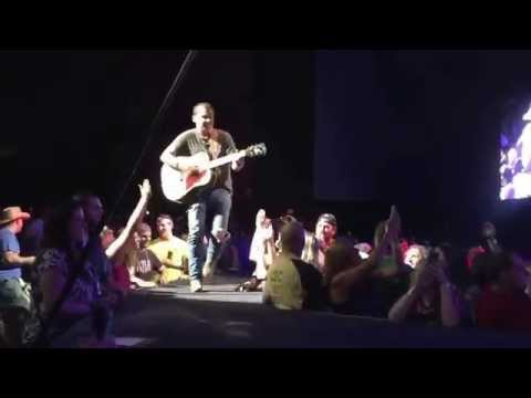 Justin Moore pulls a fan up on stage at Hartford, CT Concert to duet with him on Small Town USA!