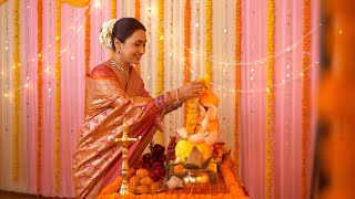 Religious Indian woman decorating temple and Ganpati idol for Ganesh Chaturthi - Garlanding Ganesh Ji Idol. Colorful Festive Background