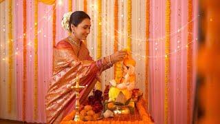 Religious Indian woman decorating temple and Ganpati idol for Ganesh Chaturthi - Garlanding Ganesh Ji Idol. Colorful Festive Background