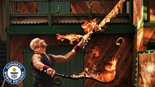 Most flaming whip crack juggling catches in one minute - Guinness World Records