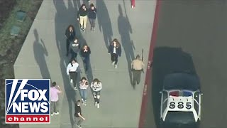 California police search for suspect in high school shooting