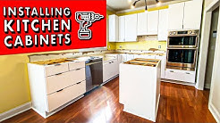 How to INSTALL KITCHEN CABINETS (and remove them)! // DIY Kitchen Remodel Pt. 1