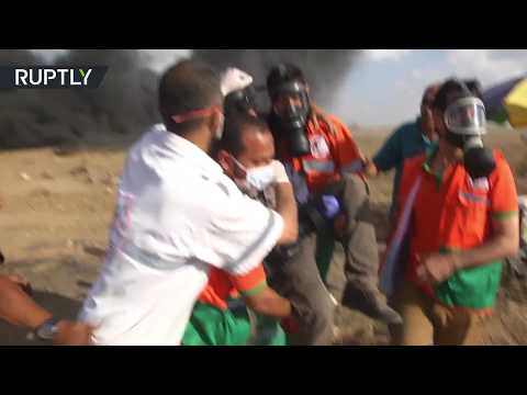 Two killed, Palestinian medics say as Gaza protest enters 14th week