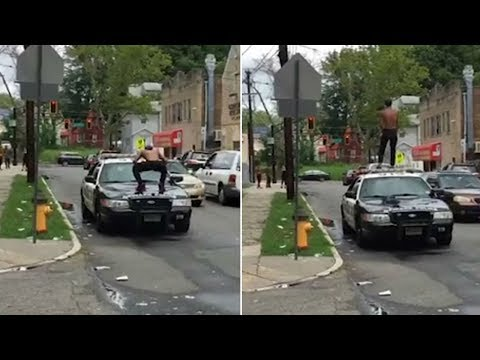 2 New Jersey officers suspended for doing 'nothing' as man jumps, stomps on police car