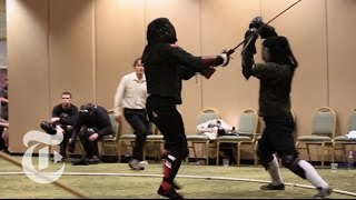 Inside the World of Longsword Fighting | The New York Times(Longsword enthusiasts are resurrecting ancient sword technique as a modern, organized sport, with timed bouts and complex rules. Produced by: Mac William ..., 2014-09-16T17:15:24.000Z)