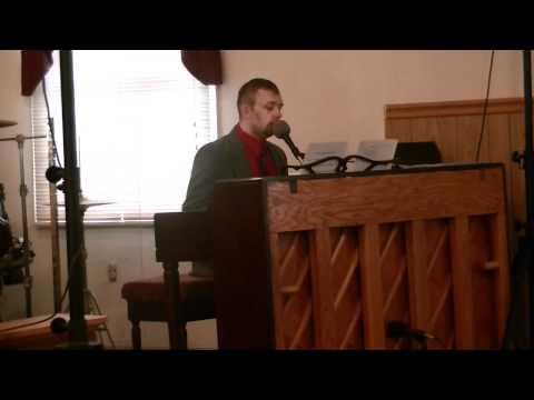 Pastor John Staton singing at Pastor Mark Dunn