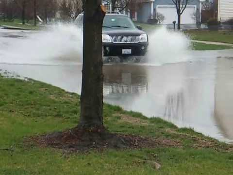 Cars driving through Chicago Flood