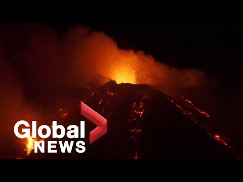 Italy's Mount Etna erupts, causing spectacular nighttime explosions