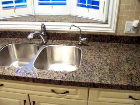 caledonia granite fireplace countertops with dark cabinets overlay new discover