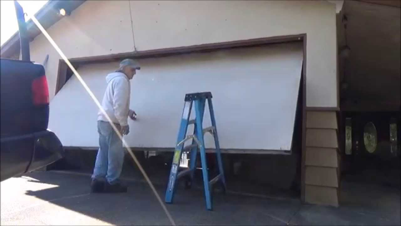 One Piece Garage Door Replaced by Sectional Door. - YouTube