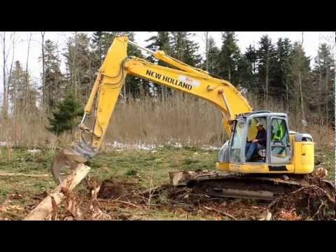NEW HOLLAND KOBELCO E235B in Action