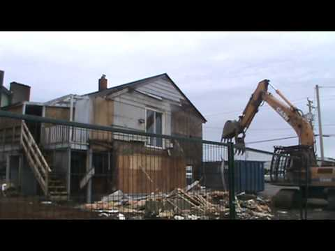 Case CX210LC excavator demolishing some stuff off a house, Nanaimo, BC